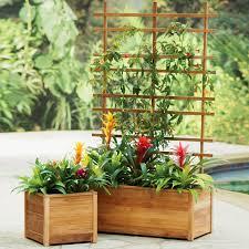 self watering teak planters built to