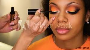 makeup artist applies maa to
