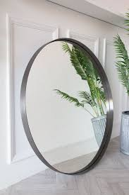 large round mirror with brushed steel
