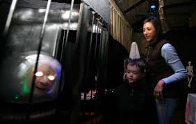 Susanne West walks through the haunted house Friday... 368827 - Connecticut  Post