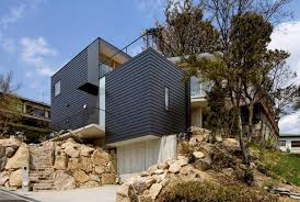 steep slope house with bookshelf lined