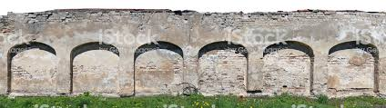 Long Fragment Of The Destroyed Ruined Arch Wall Fence From Clay Bricks And Plaster Isolated From Top Panoramic Collage From Several Photos Sunny Spring Day Landscape Stock Photo Download Image Now