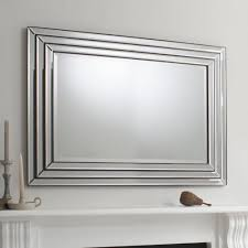large glass framed mirror with bronze