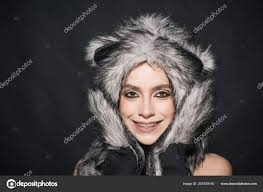 with makeup wears fluffy fur hat