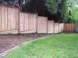 Building A Fence On Sloped Ground Fence Landscaping Building A Fence Backyard Fences