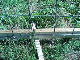 U Shaped Nails Secure Mesh Fencing To Wooden Post