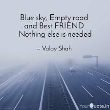 blue sky empty road and quotes writings by valay shah