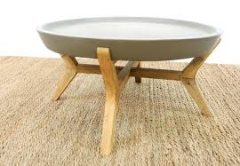 round concrete top coffee table with