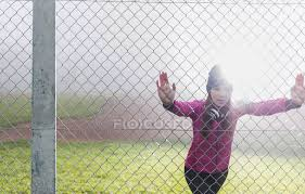 Young Woman Standing Behind Mesh Wire Fence Doing Stretching Exercises Pink Hazy Stock Photo 177234318