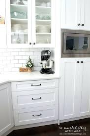 black cabinet hardware white kitchen