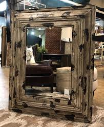 large distressed wood framed mirror