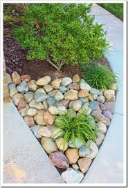 river rock landscaping projects to