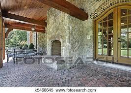 brick patio with stone fireplace stock