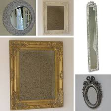 wall mounted bevelled mirror carved