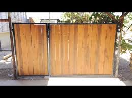 rustic wood and aged metal gate you