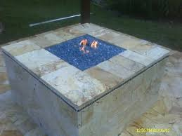 custom gas fire pit with blue fire