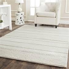 cream rectangular hand tufted area rug