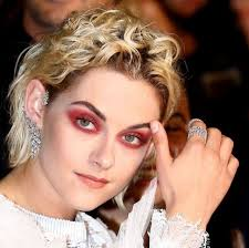 goth queen in red eye shadow in cannes