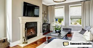 tv installation above fireplace cost