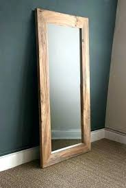 distressed wooden framed mirrors round