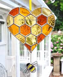 heart shaped honeycomb and ble bee