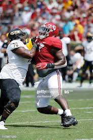 Byron Young of the Alabama Crimson Tide in action on defense ...