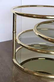 four tier smoke glass and brass swivel