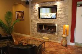 gas fireplace with tv above recessed