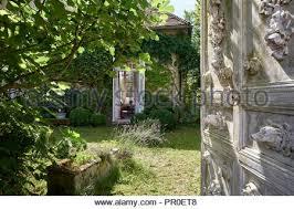 old decorative door in garden with view