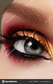 gold and red eyeshadow closeup female