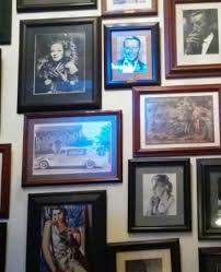 walls loaded with 100s of photo frames
