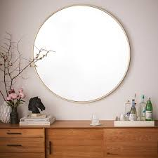 oversized gold round wall mirror