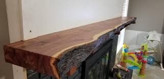 live edge red cedar fireplace mantel