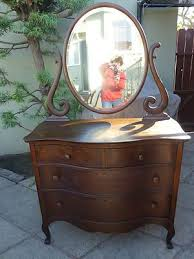 oak dresser with oval swivel mirror