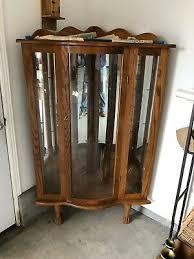 59766 antique oak bow glass lion headed