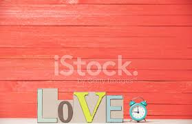 alarm clock and wooden word stock
