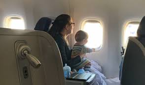 flying business cl with a baby