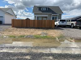 Looking For Ideas For Landscaping In Front Of The Fence Aside From Filling Those Puddle Holes Working On That Should I Put River Rocks There Mulch Mulch Line The Fence For