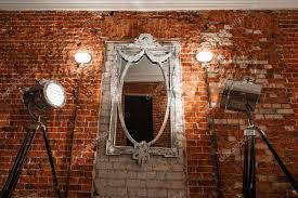 mirror glas hanging a brick wall