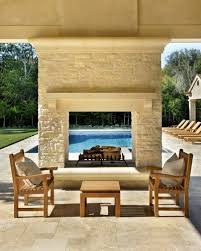 outdoor fireplace with swimming pool