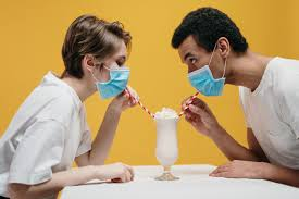 Couple Wearing Face Mask Drinking Milkshake · Free Stock Photo