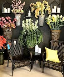 hanging wall baskets and woven chairs