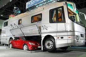 a huge luxury rv bus that even has room