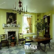 antique furniture and longcase clock in