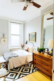 homey bedroom with neutral bedding