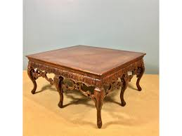 leather inlay hand carved coffee table