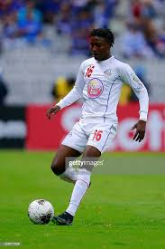 Roberto Johnson of Portmore United controls the ball during the ...
