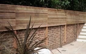 Contemporary Slatted Panels Slatted Fence Panels Essex Uk The Garden Trelli In 2020 Backyard Fences Fence Design Fence Panels