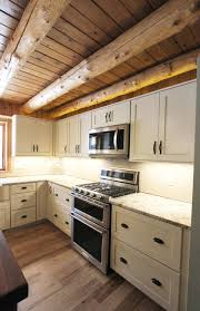 log cabin rustic white kitchen cabinets