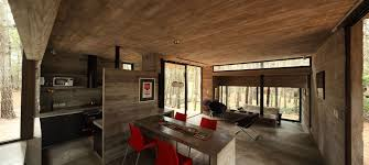 concrete home with a glass door that